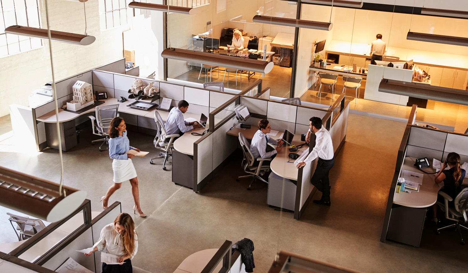 Image of office at work with engaged employees