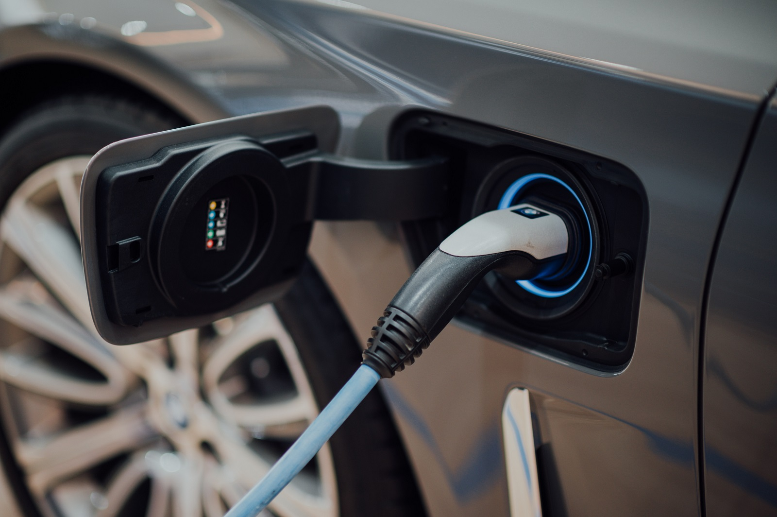 Close up of an electric vehicle being charged