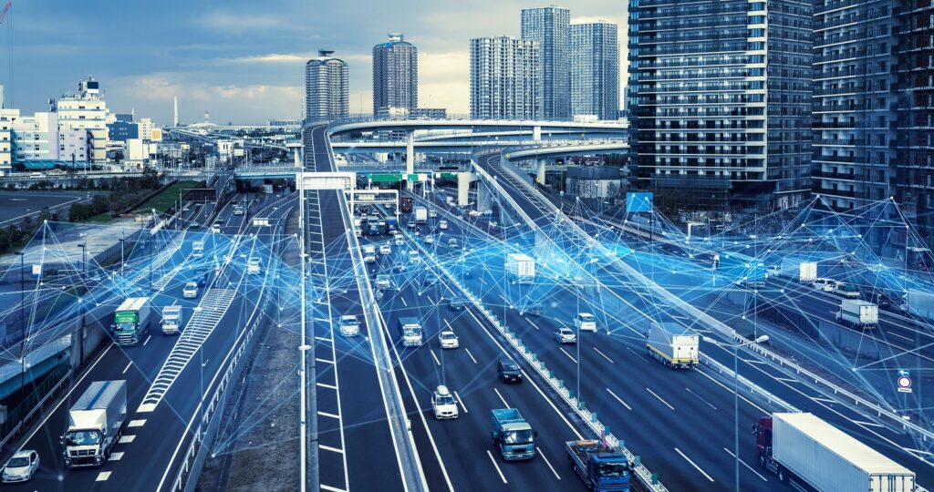 Busy road junction with telematics data flows overlaid to illustrate how data can help commercial fleet insurers